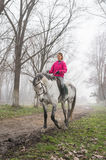 Riding in the fog Royalty Free Stock Image
