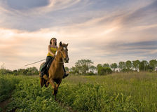 Riding girl Stock Images