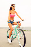 Riding her brand new bicycle. Royalty Free Stock Photo