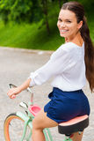 Riding her new bike in park. Stock Photos