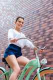 Riding her vintage bike. Royalty Free Stock Photo
