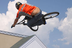 Riding High. MILFORD, CT - AUG 16: Hector Restrepo performs high-flying BMX stunts at a performance by Eastern Action Sports Teams in Milford, CT, on August 16 royalty free stock photos