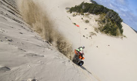 Riding hills at the dunes stock photography