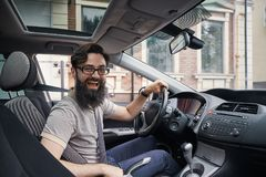 Happy charismatic man driving a car Royalty Free Stock Image