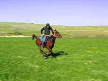 Riding a horse Royalty Free Stock Photography