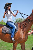 Riding a horse Stock Image