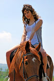 riding a horse royalty free stock photo