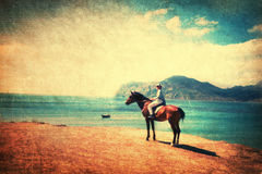 Riding horse on the beach. Picture in retro style Royalty Free Stock Photos