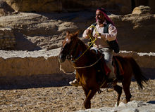 Riding on an horse. A man is riding on an horse in Petra, Jordan Royalty Free Stock Photo