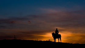 Riding a horse in sunset Royalty Free Stock Images