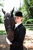 riding horseback девушки Стоковые Изображения