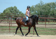Riding Horseback Стоковые Фото