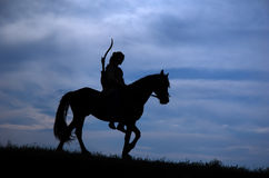 Riding horseman. Horsemen riding on the sunset Royalty Free Stock Photo