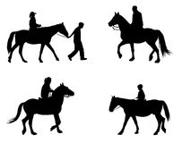 Riding horses silhouettes Stock Images
