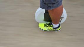 Riding an IPS balance wheel personal transporter stock footage