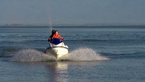 Riding on a jet ski stock footage