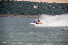 Riding a Jet ski. Stock Image