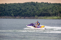 Riding a Jet ski. Stock Images