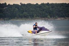 Riding a Jet ski. Stock Photo