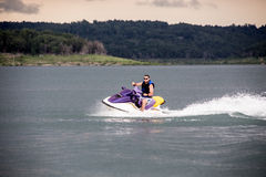 Riding a Jet ski. Stock Image