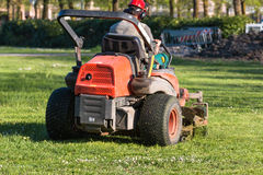Riding Lawn Equipment with operator Royalty Free Stock Photos