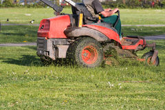 Riding Lawn Equipment with operator Stock Photography