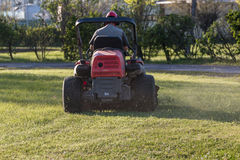 Riding Lawn Equipment with operator Stock Photos