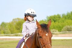 Riding Lessons. A young girl getting her first riding lessons Stock Photos