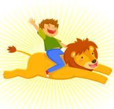 Riding a lion. Happy courageous boy riding on a lion Stock Photography