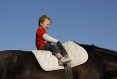 Riding little boy Stock Photography