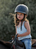 Riding little girl Stock Photo