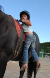 Riding little girl Stock Images