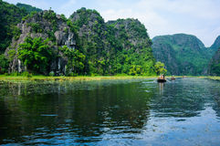 Riding long river through 3 tunnel cave. Tam Coc, Nin Binh Province, Vietnam Stock Images