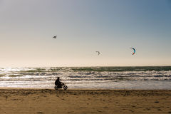 Riding mini motobike on the beach filming Stock Photography