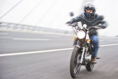 Riding motorbike Stock Photos