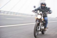 Riding motorbike Stock Photos