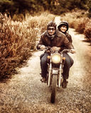 Riding on motorbike Royalty Free Stock Images
