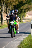 Riding the motorcycle. Young couple riding the motorcycle royalty free stock photography