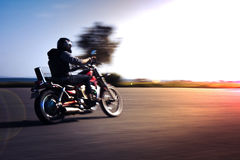 Riding motorcycle. Pan technic used royalty free stock images