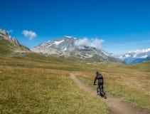 Riding mountain bicycle through mountains Royalty Free Stock Image