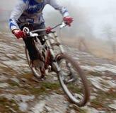 Riding a mountain bike. A young man riding a mountain bike downhill style Royalty Free Stock Photos