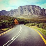 Riding into mountains. Riding my motorcycle into the mountains of cape town royalty free stock photo