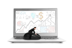 Riding mouse on laptop with business doodles on screen Royalty Free Stock Photos