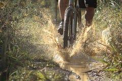 Riding Through Mud stock photography