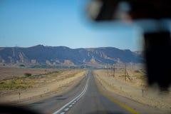 Riding through negev desert stock image