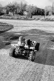 Riding off into the susnset. A boy and a girl drive a power wheels in the setting sun. -Victor, MT Royalty Free Stock Photo