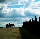 Riding in the park. Carriage under blue sky Stock Image