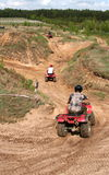 The riding on a quad. Sportsmen riding on a quad Stock Photo