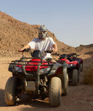 Riding quad bikes in desert Royalty Free Stock Photos