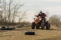 Riding a quad on the off-road. Biskupice Radlowskie, Poland - January 14, 2018: Riding a quad on the off-road Royalty Free Stock Photo